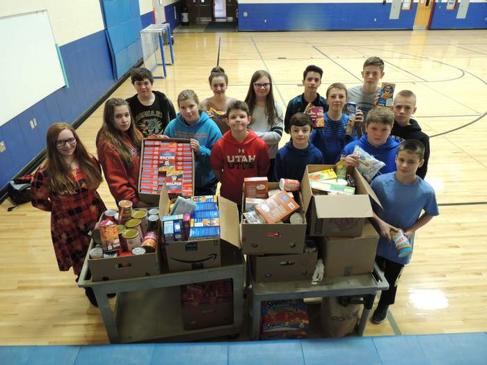 Service Learning Team with food drive items