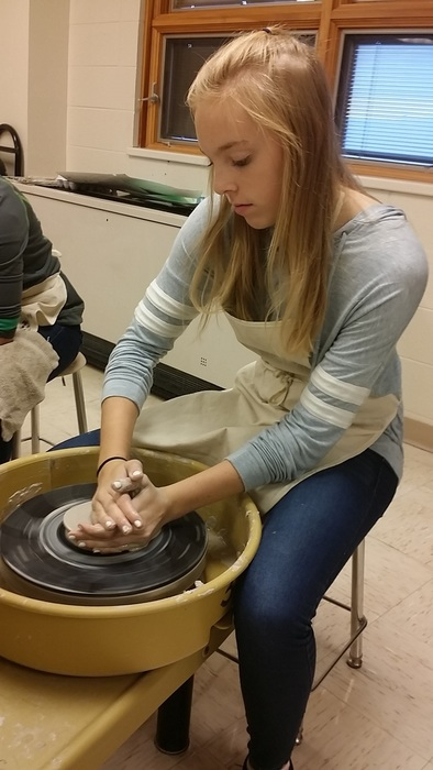 Emma on the pottery wheel